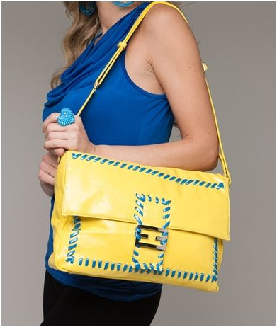 yellow and blue stitched handbag